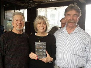 Susan at her book signing pictured with her writing coach Jedwin Smith (L) and husband Mike Jimison (R), a Vietnam pilot.