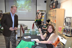 Travis Taylor, founder of the tourist blog, wanderlust Atlanta, getting his signed copy of Moving to Atlanta.
