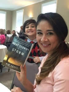 Kim Cross, her son in the background, at the Roswell Reads Literary Luncheon held on March 12.
